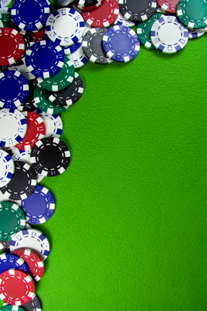Many poker chips on casino table