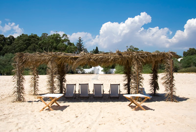 Canvas Chairs on tropical beach over blue sky
